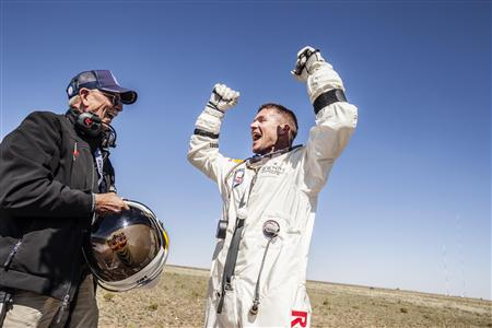 Handout photo of life support engineer Mike Todd of the U.S. and pilot Felix Baumgartner of Austria celebrating after Baumgartner successfully completed the final manned flight for Red Bull Stratos in Roswell